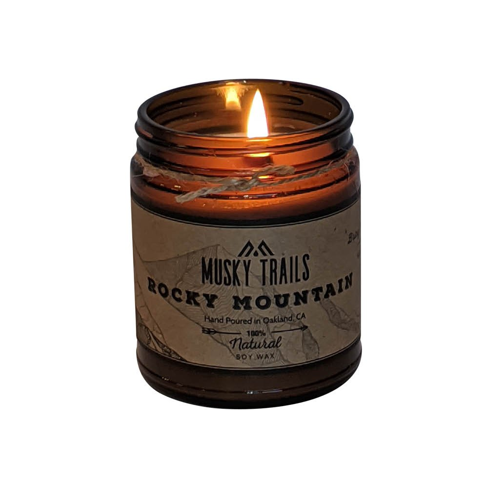 rocky mountain national park candle 8oz amber jar lit
